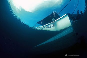 Mabul island dive boat from under the jetty, 16mm fisheye... by Katherine Edwards 